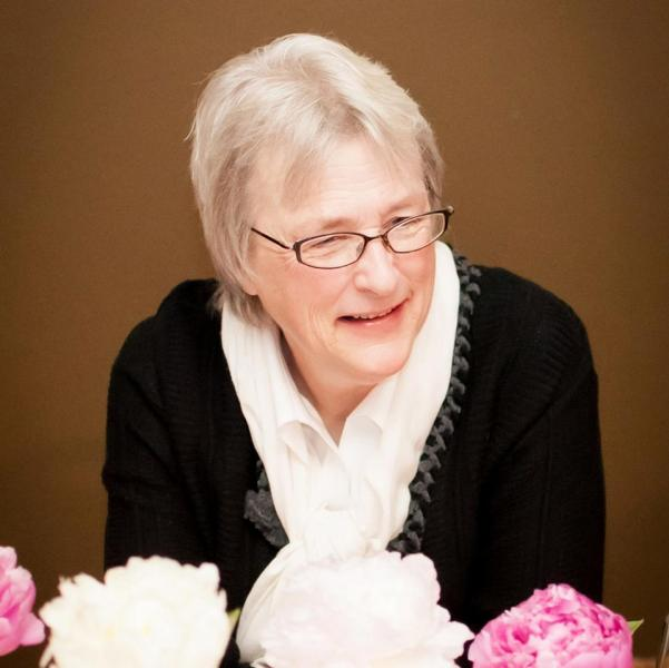Color photograph of Libby Manthey, Riverwalk Books' owner and founder